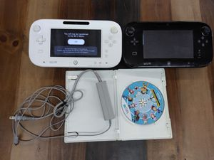 Wii u bundle including two controllers one game and charger for Sale in Tampa, FL