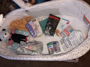 Delta Bassinet & Newborn Clothes/items included for Sale in Streamwood, IL