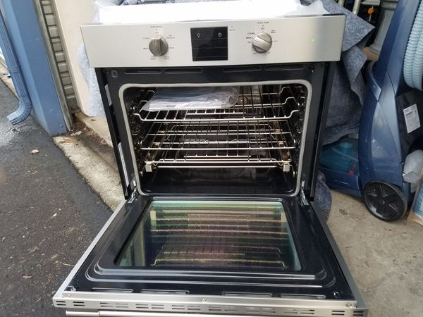 Stainless Steel Frigidaire oven set with Stainless Steel Frigidaire Microwave digital.
