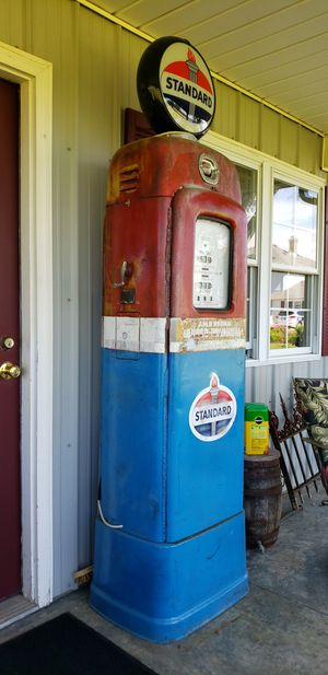 Antique Gas Pump (s) and Furniture Vintage Coca Cola and Candy Machine + Iron Fence and Wagon Wheel for Sale in Shelbyville, IN