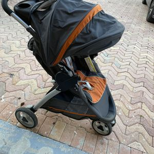 Free Orange And Grey Jogger Stroller for Sale in Miami, FL