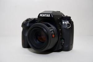 Pentax K-5 DSLR camera w/2 lenses like new in box for Sale in Boca Raton, FL