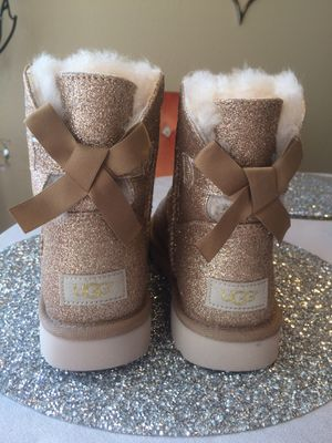 Brand new UGG mini bow sparkle glitter boots booties shearling fur lined size 5 & 6 NEW gold $95 each for Sale in Los Angeles, CA