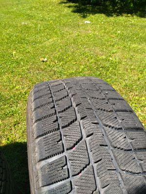 Four Bridgestone tires on alloy wheels 205 55R 16 studless. We're on a V70 Volvo $400.00 for Sale in Endicott, NY
