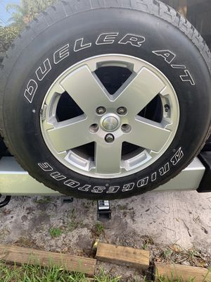 5 stock / 2012 Jeep Wrangler wheels and tires for Sale in Odessa, FL