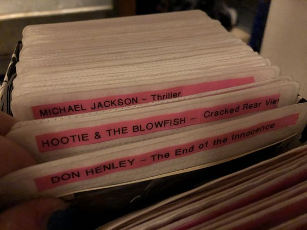 Box of various pop/rock CDs