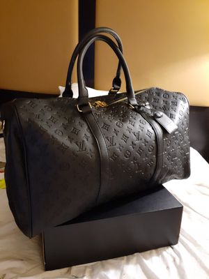 Louis Vuitton Bandouliere 55 Shadow Monogram Embossed with gold accents for Sale in Dallas, TX
