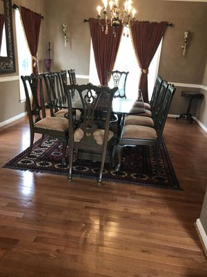 Antique hand carved wooden table with 8 chairs for Sale in Oakton, VA