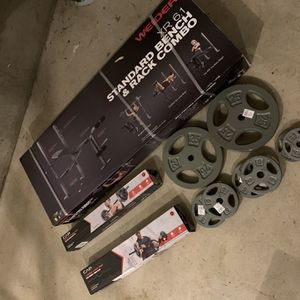 Bench press Rack , straight bar, curl bar, and 75lbs in weight plates for Sale in Happy Valley, OR