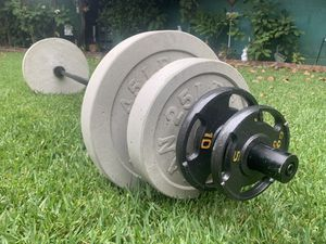 Olympic barbell with weights for Sale in Santa Fe Springs, CA
