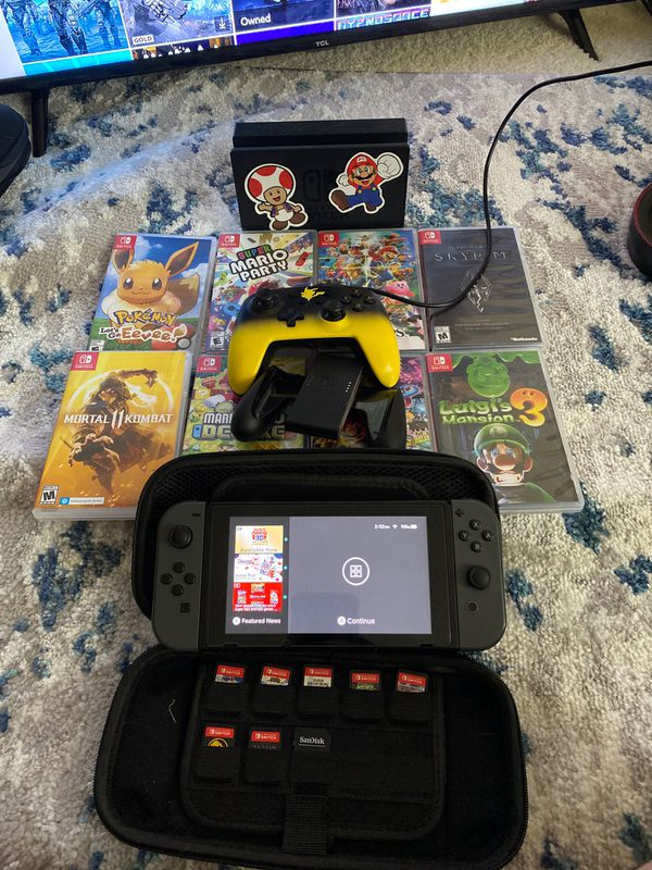 Nintendo Switch+ 8 games, 128gb sd card, button mapping control, and case