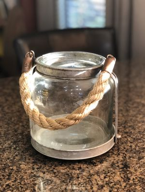 """Heavy nautical style glass and metal candle holder with thick rope accents. 7""""t x 7""""w. for Sale in Tolleson, AZ"""