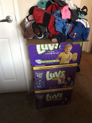 Boxes full of kids cloths boy up to 18m girl up to 2T for Sale in Riverside, CA