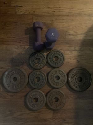 35 pounds of weight total. Six 2.5 and two 5 standard 1 inch plates and a paid of dumbbells for Sale in Jersey City, NJ