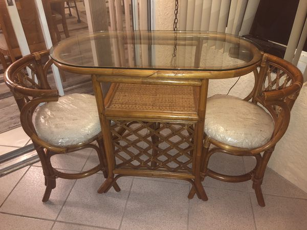 Wicker glass table and chairs