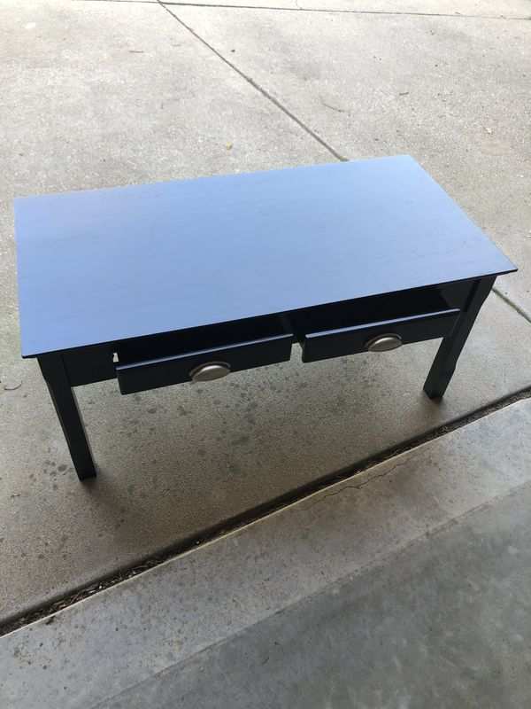 Back coffee table. 38 inches long, 19 inches wide and 17 inches tall. $25, OBO.
