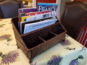 Sturdy wicker magazine rack with slots for remote controls or other things for Sale in Plano, TX