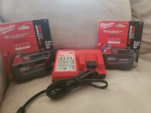 Milwaukee M12 and M18 Charger and Two Milwaukee M18 Red Lithium XC 5.0 Batteries for Sale in Downey, CA