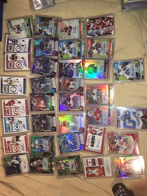 37 nfl rc, autos some numbered plus hyper green prizm and optic bronze prizm and contender green perelels over $350 worth the cards for Sale in Chino, CA