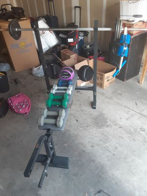 Like new Weider weight bench plus barbell with 40 pounds of weights so all together 70 pounds plus dumbells for Sale in Las Vegas, NV