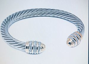 Cable bangle bracelet with two tones endless bottoms for Sale in Orlando, FL