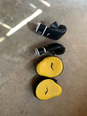 Everlast Punching bag and 3 different sets of boxing gloves for Sale in Marietta, GA