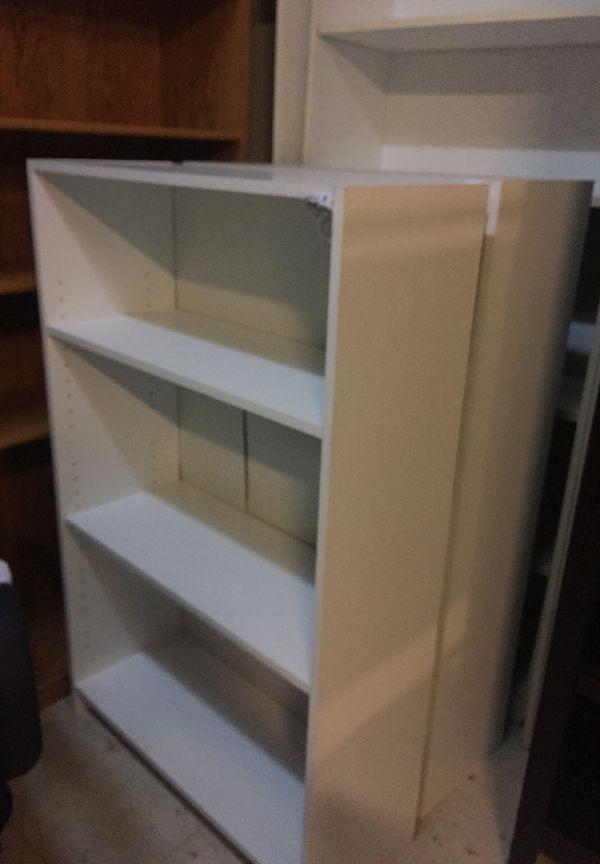 "Medium size white bookcase 30"" wide 48"" tall"