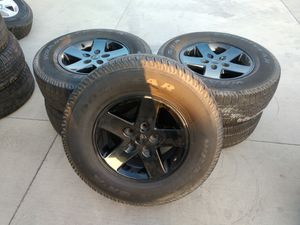 """JEEP wheels OEM 17"""" and tires 12 set's available for Sale in Montclair, CA"""