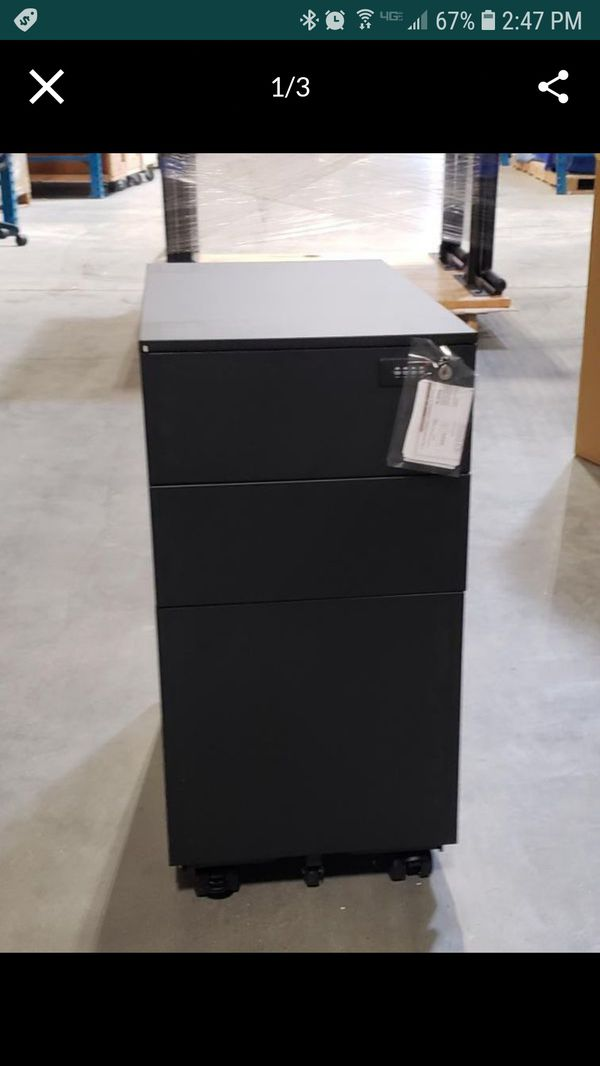 NEW in BOX slim mobile filing cabinets. Total of 22. Will lock with combo included. Black on wheels.