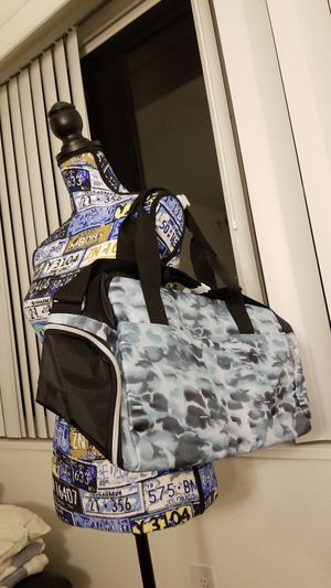 Blue and black camouflage duffle bag for Sale in Alexandria, VA