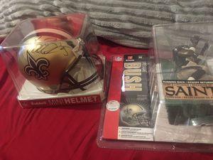Reggie bush autographed mini helmet and Figure for Sale in Phoenix, AZ