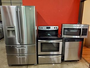Stainless steel appliances set fridge stove dishwasher microwave all good working conditions set for $999 for Sale in Denver, CO