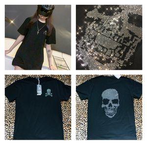 New loose black t-shirt top tee skull bones rhinestones sequins crystals short sleeve punk rock wide blouse hoodie shirt for Sale in Gaithersburg, MD