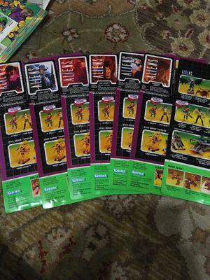 7 aliens action figures back boards for Sale in San Antonio, TX