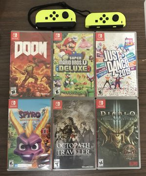 Nintendo Switch video game console system games New Super Mario Bros U Deluxe Octopath Traveler Doom Spyro just Dance Diablo 3 Neon Yellow joycons jo for Sale in Cleveland, OH