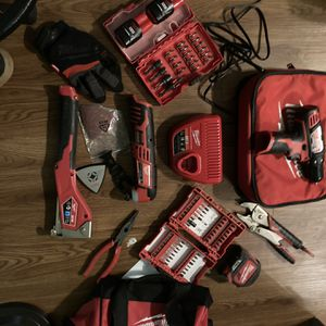 Milwaukee Drill/ Driver, Multi Tool , Stapler,2 M12 Battiers, 1 Charging Station 1 Vice Grip 1 25ft Tape 1 Needle Nose Pliers, 2 Case Of Shock Wave for Sale in Nashville, TN