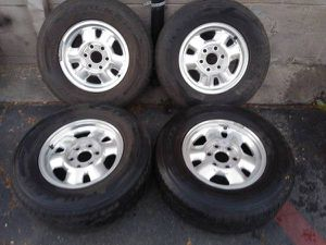 6 lug Chevy or GMC 16 inch alloy rims with old tires for Sale in Montebello, CA
