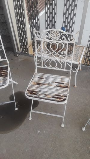 Iron porch furniture just need a little bit of Tender Care good shape hanging plants shelves and baskets and two umbrella holders for Sale in Cleveland, OH