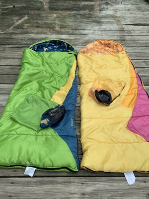 2 - Youth sleeping bags for kids . Comes with travel bag. Without stretching, they are about 2ft wide x 4.5 ft long. for Sale in Waukegan, IL