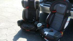 I have two Graco grow with me car seats. They are in five stages. They go from second stage all the way up to booster seat. 12 to 120 lb. for Sale in Wilmington, NC