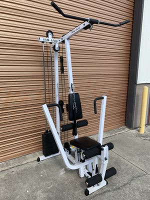 Body Solid EXM-1500: Chest Press, Lat Pull, Ab Crunch, Leg Extension, Low Row-150 Lb Stack for Sale in Davenport, FL