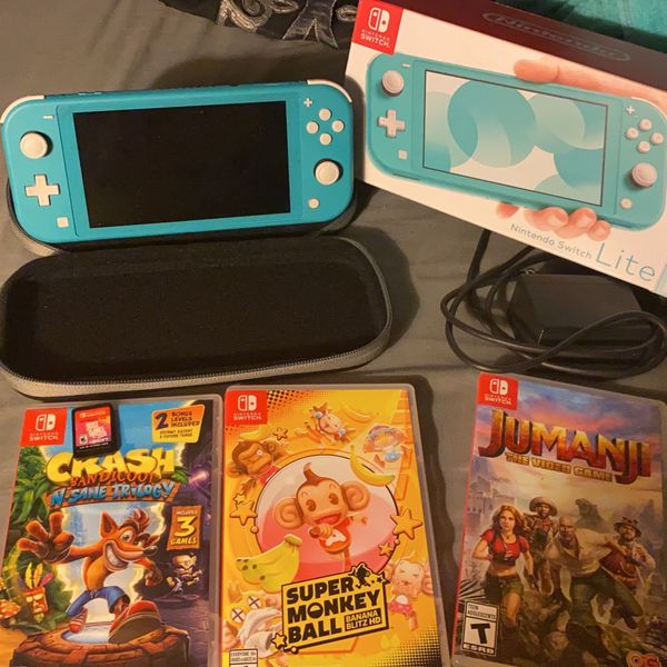 Nintendo Switch Lite Barely Used With 4 Games & Carrying Case