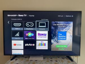 Sharp 59 inch Smart TV with TV stand for Sale in Boston, MA