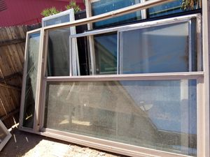 SLIDER DOOR WITH TRANSOM WINDOW ON TOP SIZE IS 71 1/2 WIDE 114IN TALL WITH OUT TOP WINDOW PIECE for Sale in Phoenix, AZ
