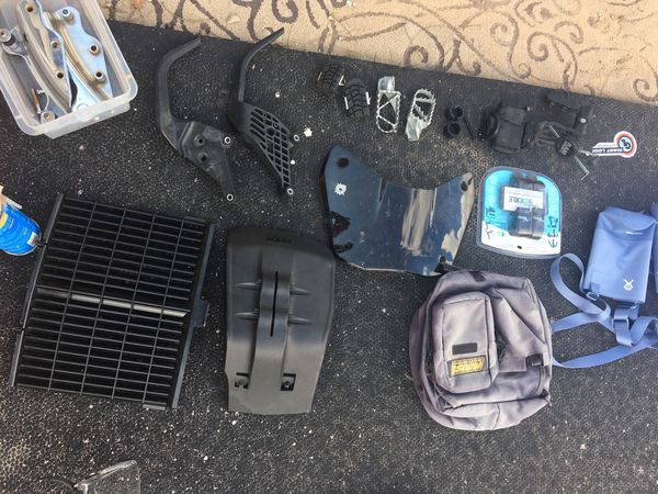 Random motorcycle stuff luggage seat brake pads parts