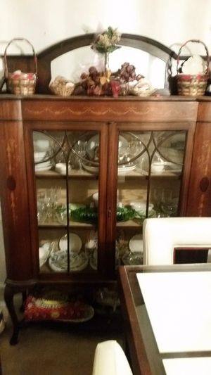 Antique china cabinet with original bamboo paper lining and marchery inlay in good condition. Price to sell at 500$ worth much much more. Will have for Sale in Conyers, GA