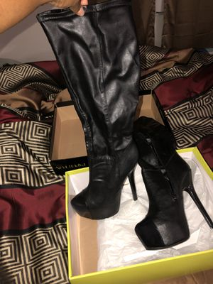 Black heeled boots for Sale in Chesterfield, MO