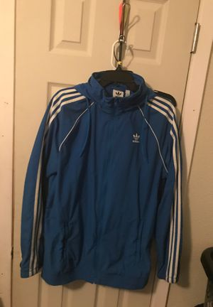 Blue adidas jacket w/ retractable hoodie and strings for Sale in Cypress, TX
