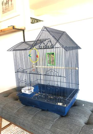 Bird cage with slide out tray and toys mirror dishes perch for Sale in Tacoma, WA