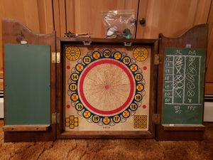 Cork, two sided dart board with wood cabinet. Traditional game on one side, baseball game on reverse side. for Sale in Kulpsville, PA